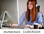 smiling girl at working place... | Shutterstock . vector #1128192224