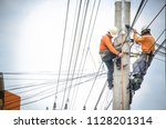 electricians are climbing on... | Shutterstock . vector #1128201314