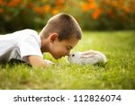 Stock photo little boy with rabbit 112826074