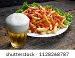 fried potato with beer | Shutterstock . vector #1128268787