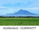merapi mount with green field  | Shutterstock . vector #1128304277