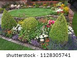 a walled country garden with... | Shutterstock . vector #1128305741