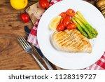 a dish of chicken breast | Shutterstock . vector #1128319727
