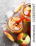 peach ice tea on a gray... | Shutterstock . vector #1128325367