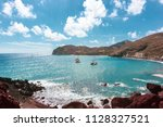 the famous red beach in... | Shutterstock . vector #1128327521