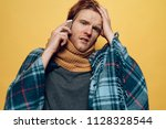young sick guy wrapped in plaid ... | Shutterstock . vector #1128328544