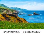 rocks sticking up out of blue... | Shutterstock . vector #1128350339