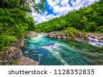 forest river landscape. wild... | Shutterstock . vector #1128352835