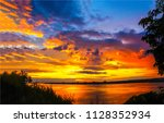 sunset river sky clouds... | Shutterstock . vector #1128352934