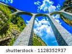 stone railway bridge in... | Shutterstock . vector #1128352937