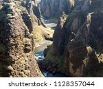 blue river and high rocks ... | Shutterstock . vector #1128357044