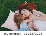 smiling woman and little cute... | Shutterstock . vector #1128371225