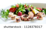 octopus with salad | Shutterstock . vector #1128378317