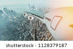 aircraft flying in the city... | Shutterstock . vector #1128379187
