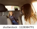 mom and daughter in the car at... | Shutterstock . vector #1128384791