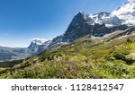 spectacular view on eiger north ... | Shutterstock . vector #1128412547