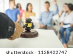 close up auctioneer hand  black ... | Shutterstock . vector #1128422747