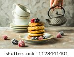 a pile of pancakes on a plate... | Shutterstock . vector #1128441401