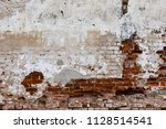 old weathered red bricks wall... | Shutterstock . vector #1128514541