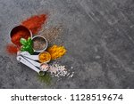flat lay of various spices in... | Shutterstock . vector #1128519674