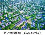 sunset real estate suburb homes.... | Shutterstock . vector #1128529694