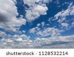 beautiful fluffy clouds on a...   Shutterstock . vector #1128532214