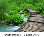 Wooden Path And Waterfall In...