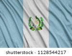 guatemala flag  is depicted on...   Shutterstock . vector #1128544217