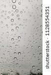 rain drops on the windshield. | Shutterstock . vector #1128554351