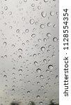 rain drops on the windshield. | Shutterstock . vector #1128554354