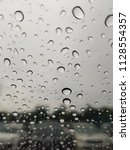 rain drops on the windshield. | Shutterstock . vector #1128554357