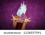 funny girl unicorn is very... | Shutterstock . vector #1128557591