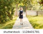 schoolgirl in uniform with a... | Shutterstock . vector #1128601781
