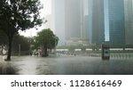 singapore  26 may 2018. heavy... | Shutterstock . vector #1128616469