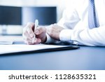 businessman hand signing... | Shutterstock . vector #1128635321