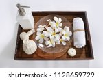 many white frangipani in bowl... | Shutterstock . vector #1128659729