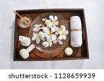 many white frangipani in bowl... | Shutterstock . vector #1128659939