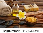 spa setting with frangipani oil ... | Shutterstock . vector #1128661541