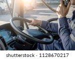 semi truck truck driver making... | Shutterstock . vector #1128670217