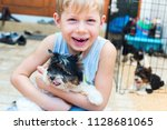 happy caucasian boy lovingly... | Shutterstock . vector #1128681065