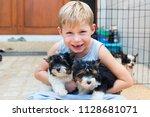 happy caucasian boy lovingly... | Shutterstock . vector #1128681071