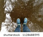 in rubber boots in the middle... | Shutterstock . vector #1128688595