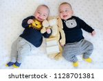two adorable twin babies... | Shutterstock . vector #1128701381