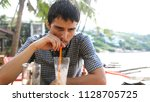 pensive handsome young man... | Shutterstock . vector #1128705725