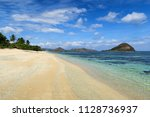 white sand clear beach with... | Shutterstock . vector #1128736937
