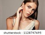 beauty woman face portrait.... | Shutterstock . vector #1128747695