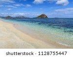white sand empty clear beach... | Shutterstock . vector #1128755447