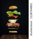 tasty ham sandwich  levitating  ... | Shutterstock . vector #1128764801