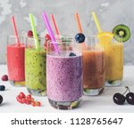 detox smoothies with tropical... | Shutterstock . vector #1128765647
