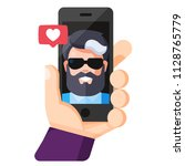 human hand holding mobile phone ... | Shutterstock .eps vector #1128765779